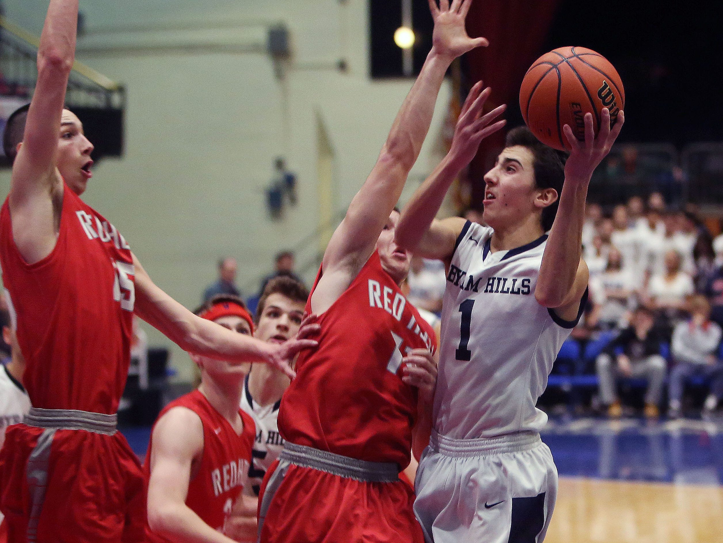 Byrom Hills' Matt Milone (1) drives to the basket against Red Hook during the boys Class A basketball playoff game at the Westchester County Center in White Plains March. 1, 2016.