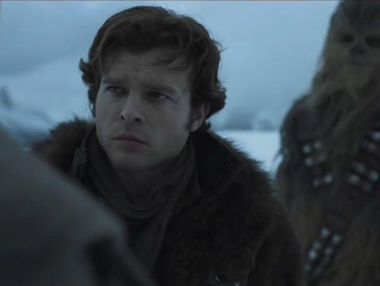 "Solo (Alden Ehrenreich) listens to the mission in ""Solo:"
