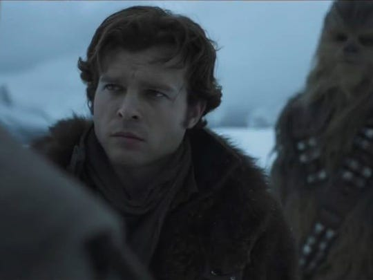 """Solo (Alden Ehrenreich) listens to the mission in """"Solo: A Star Wars Story."""""""