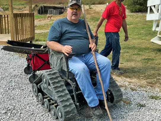 Veteran Jim Payton, also a volunteer for HERO, tests