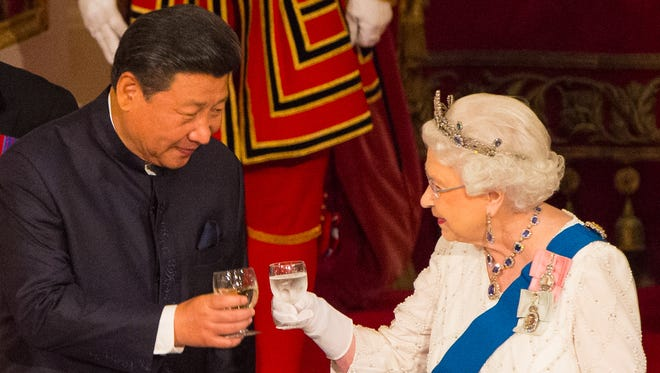 Chinese President Xi Jinping toasts Queen Elizabeth II during a state banquet at Buckingham Palace in London in October 2015.