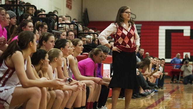 oCVU head coach Ute Otley watches the action on the court during the girls basketball game between the Essex Hornets and the Champlain Valley Union Redhawks at CVU high school on Tuesday night January 26, 2016 in Hinesburg. (BRIAN JENKINS/for the FREE PRESS)