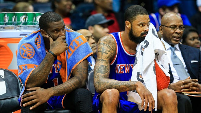 Knicks power forward Amar'e Stoudemire, left, and center Tyson Chandler sit on the bench as the clock winds down in the second half against the Atlanta Hawks at Philips Arena on Saturday night.