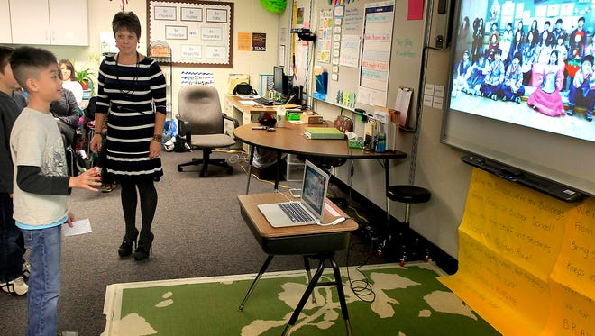 Badger Elementary School student Vu Do introduces himself to a class in South Korea on Tuesday in Grand Chute.