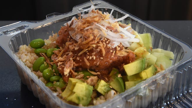 A spicy tuna role is ready to be served during lunch at Big Fish Poke in Thousand Oaks.