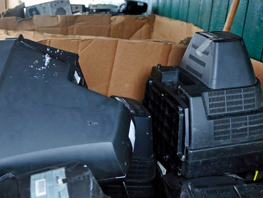 Discarded TVs are seen Tuesday, March 24, 2015 at Washington