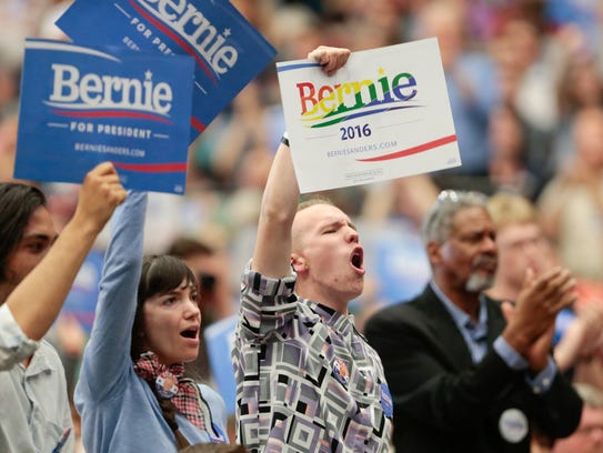Supporters cheer as Democratic presidential candidate