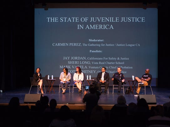 Carmen Perez, left, leads a panel discussion during
