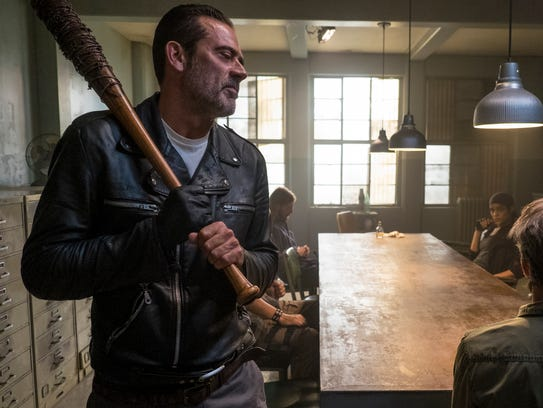 Bat-wielding Negan (Jeffrey Dean Morgan), left, and