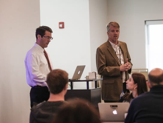 From left, Aaron Walsh, director of Immersive Education Initiative and Farmington High School Principal Tim Kienitz prepare for a presentation on Friday during a seminar on programming and coding through gaming at Farmington High School.