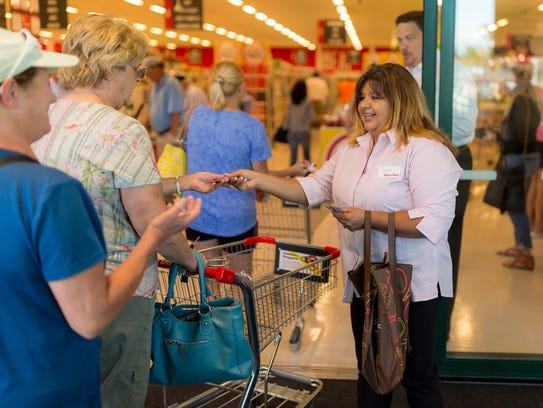The first 500 customers to enter the remodeled Winn-Dixie
