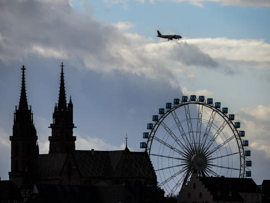 A jet flies above Basel, Switzerland.