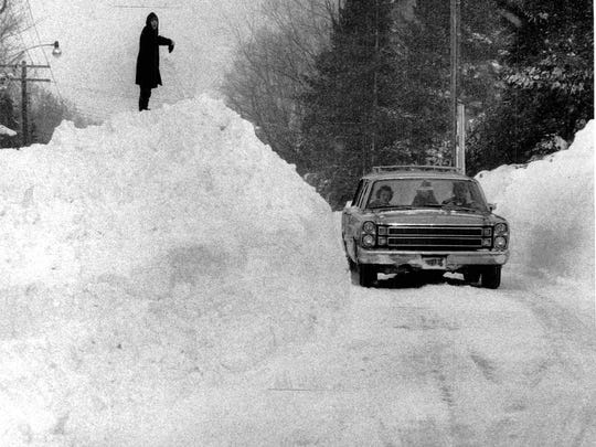 A huge snowpile along East Avenue in Pittsford in after an epic snowstorm in February 1966