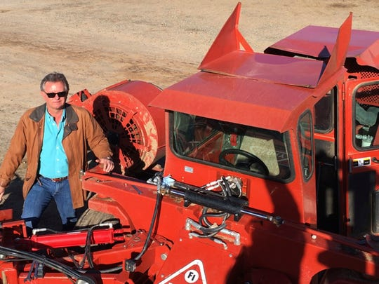 Farmer Kevin Herman stands next to an almond sweeper at his ranch near Madera. Herman says Donald Trump's campaign vow to deport millions of immigrants who are in the country illegally pushed him into buying more equipment, cutting the number of workers he'll need during the next harvest.