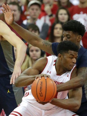 UW's Khalil Iverson (left) has played well at times, but the UW staff is looking for more consistency from him and others as the Badgers adjust to losing Kobe King and D'Mitrik Trice to injuries.