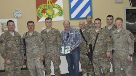 From left to right, Col. Cameron Cantlon, native of Ettrick, Wis., Cpl. Alex Strauss, native of Port Washington, Wis., Pfc. Ryan Mcquillin, Congressman Reid Ribble, Staff Sgt. Jason Ory, native of Greendale, Wis., Maj. Raymond Longabaugh, Chief Warrant Officer 2 Brian Reddington, and Sgt. Jason Lindstrom, native of Milwuakee, Wis.