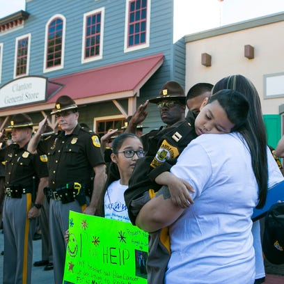 Officers salute captain for the day, Angel De Jesus