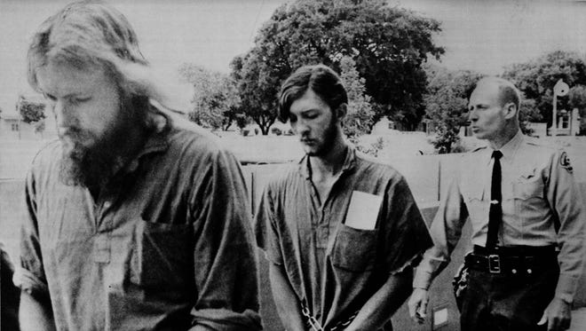 Stanley Dean Baker, left, 22, and Harry Allen Stroup, 20, are returned to the county jail in Monterey, Calif., by Bailiff Earl Press after they waived extradition to Montana at Municipal Court in Salinas, Calif., on July 15, 1970.