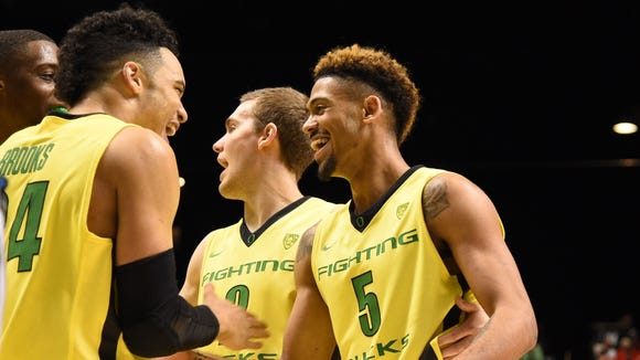 March 12, 2016; Las Vegas, NV, USA; Oregon Ducks forward Dillon Brooks (24) congratulates guard Tyler Dorsey (5) against the Utah Utes during the second half in the championship game of the Pac-12 Conference tournament at MGM Grand Garden Arena. Mandatory Credit: Kyle Terada-USA TODAY Sports