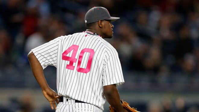 New York Yankees starting pitcher Luis Severino (40) watches a video replay of the fourth-inning, solo home run he gave up too Boston Red Sox designated hitter David Ortiz in a baseball game at Yankee Stadium in New York, Sunday, May 8, 2016.