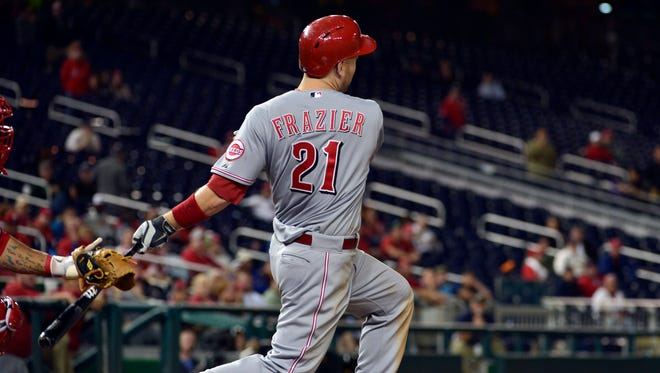 Cincinnati Reds third baseman Todd Frazier (21) hits a two-run home run during the 15th inning against the Washington Nationals at Nationals Park.