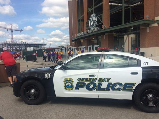 Green Bay police car sits outside Lambeau Field before the Wisconsin-LSU football game Saturday, Sept. 3, 2016.
