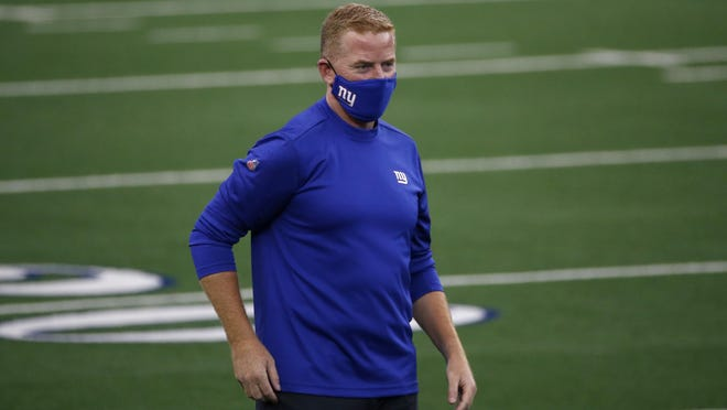 New York Giants offensive coordinator Jason Garrett watches workouts before an NFL football game against the Dallas Cowboys in Arlington, Texas, Sunday, Oct. 11, 2020. The game marks the first time Garrett has returned to play against the team he was the head coach of last season.