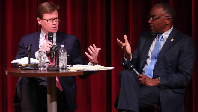 Charles Robert Bone with Transit for Nashville, left, and jeff obafemi carr with NoTax4Tracks, participate in a transit debate Tuesday, April 10, 2018, at the Nashville Public Library.