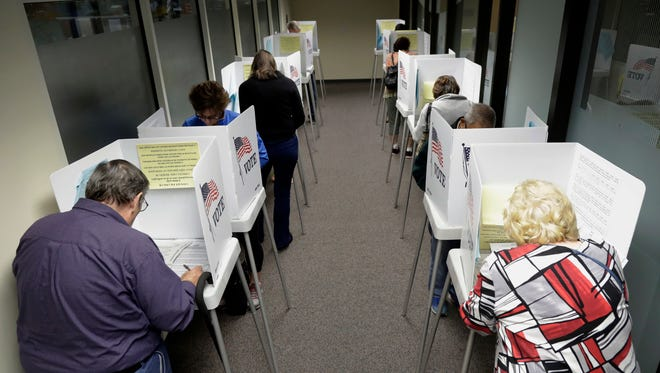 Voters cast their ballots at the Santa Clara County Registrar of Voters office on Monday in San Jose.