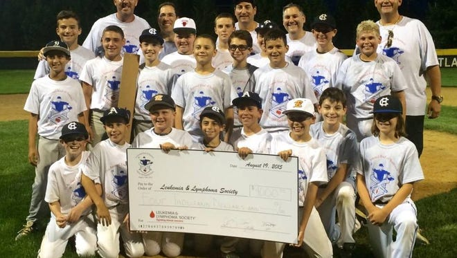 Cherry Hill Baseball Classic players with $4,000 check for The New Jersey Chapter of The Leukemia & Lymphoma Society