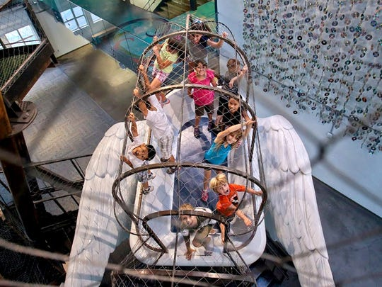 Kids play in one of the many imaginative interactive features at the Children's Museum of Phoenix.