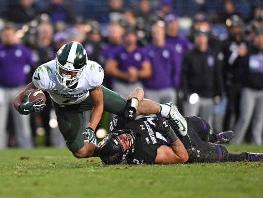 MSU freshman Cody White reaches for more yards after