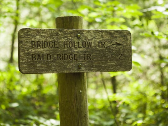 A sign directs hikers to Bridge Hollow Trail, which Dalton Hoerner and his mom, Bridget Hoerner, accidentally missed resulting in an unintended 14-hour trek in an oppositie direction through woods near their West Augusta home.