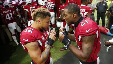 Arizona Cardinals free safety Tyrann Mathieu (32) and cornerback Patrick Peterson (21)  get ready to play against the Tampa Bay Buccaneers at University of Phoenix Stadium in Glendale, Ariz. September 18, 2016.