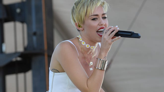 """While one woman is credited as one of the writers of Miley Cyrus' song """"Wrecking Ball,"""" so are four men."""
