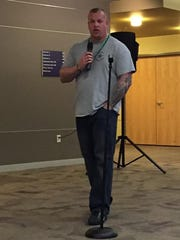 Justin Lee gives a talk for his organization in March.