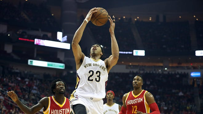 New Orleans Pelicans forward Anthony Davis (23) shoots while Houston Rockets guard Patrick Beverley (2) center Dwight Howard (12) watch in the first quarter at Toyota Center.