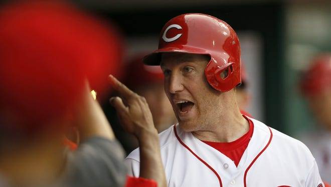 Cincinnati Reds third baseman Todd Frazier (21) cheers in the dugout after hitting a solo home run.