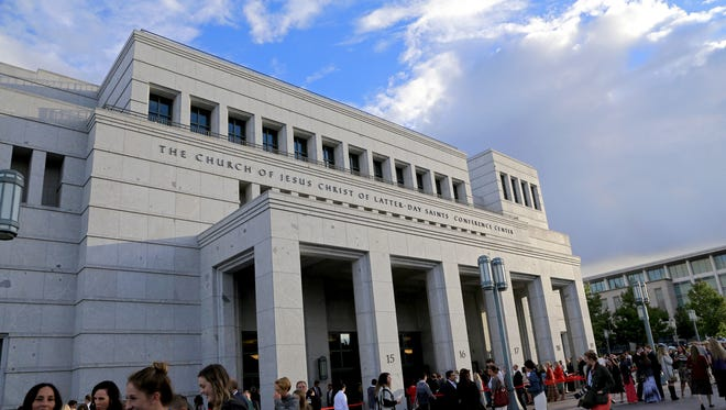 Members of The Church of Jesus Christ of Latter-day Saints gather Sunday morning for the faith's 185th Semiannual General Conference at the Conference Center in Salt Lake City.