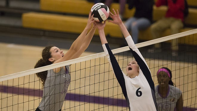 Johnston's Taryn Knuth, left, goes head to head against Roosevelt's Piper Mauck during the Class 5A regional volleyball match at Johnston High School in Johnston, Thursday, Oct. 29, 2015.