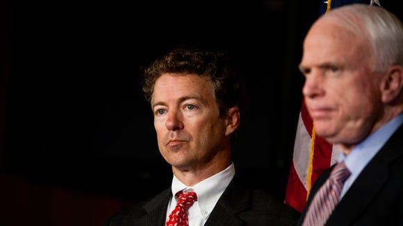 Sens. Rand Paul, R-Ky., left, and John McCain, R-Ariz.,