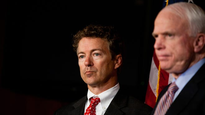 Sens. Rand Paul, R-Ky., left, and John McCain, R-Ariz., are exchanging insults again in their long-running feud over national security.