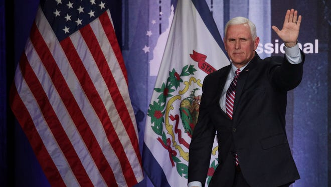 U.S. Vice President Mike Pence leaves after he addressed a dinner at the 2018 House & Senate Republican Member Conference January 31, 2018 at the Greenbrier resort in White Sulphur Springs, West Virginia. Congressional Republicans are gathered at their annual retreat, hosted by the Congressional Institute, to discuss legislative agenda for the year.