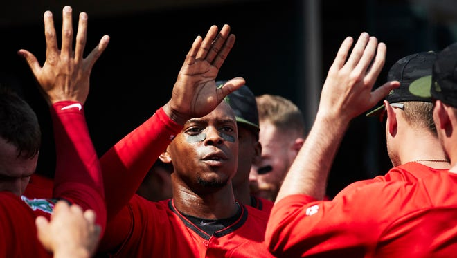 May 28, 2018; Detroit, MI, USA; Los Angeles Angels left fielder Justin Upton (8) is congratulated by teammates after scoring in the eighth inning against the Detroit Tigers at Comerica Park. Mandatory Credit: Rick Osentoski-USA TODAY Sports