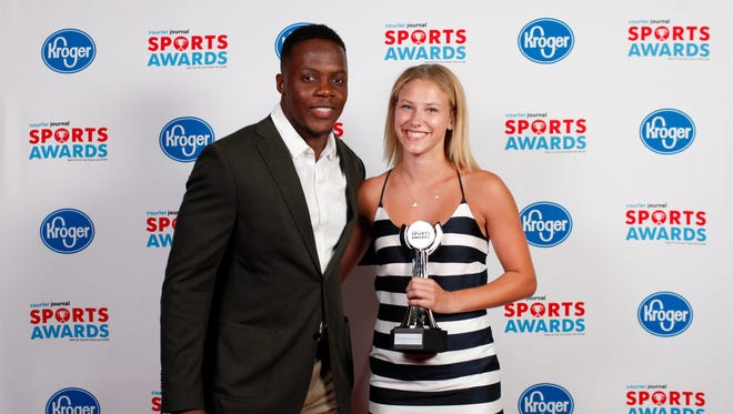 Teddy Bridgewater poses with Jacquelyn Wilkins, winner of the Field Hockey Player of the Year award, during the 2018 Courier Journal Sports Awards held at The Louisville Palace in downtown Louisville. June 7, 2018