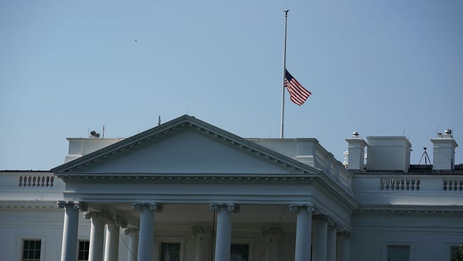WASHINGTON, DC - JULY 03:  An American flag flies at half-staff on top of the White House July 3, 2018 in Washington, DC. After reports about President Donald Trump's rejection for a flag lowering request from Annapolis Mayor Gavin Buckley on Monday, the White House ordered U.S. flags to lower to half-staff in remembrance of the mass shooting at The Capital Gazette in Annapolis, Maryland.  (Photo by Alex Wong/Getty Images) ORG XMIT: 775186133 ORIG FILE ID: 990698508