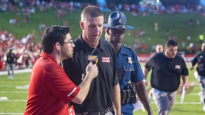 UL coach Billy Napier, being interviewed here by radio sideline reporter Cody Juneau, played his college ball at Furman.