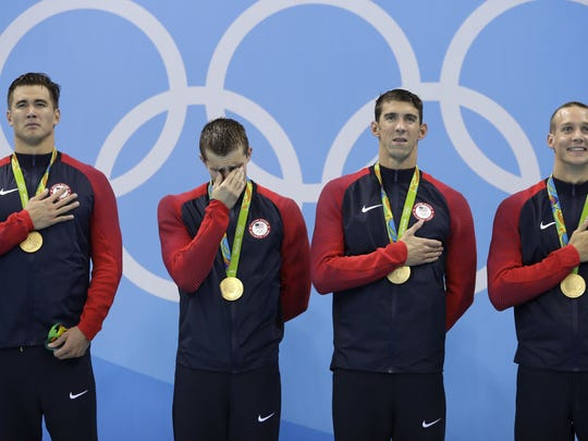 Competing at the Olympic level is emotional, win or lose. From right, Caeleb Dressel, Michael Phelps, Ryan Held and Nathan Adrian during the medal ceremony after winning a gold medal in Rio on Aug. 8.