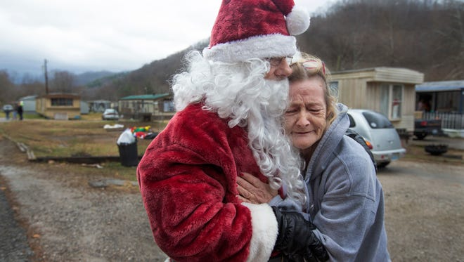 Juanita Johnson gave Mike Howard a heartfelt hug while the Mountain Santa was delivering Christmas gifts to residents of the Elcomb hollow in Harlan County, Ky.