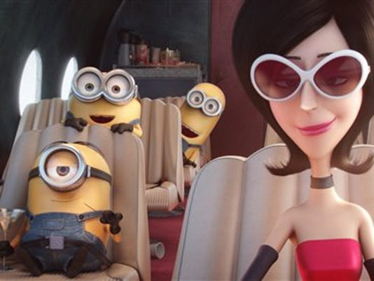 "In this image released by Universal Pictures, characters, from left, Stuart, Bob, Kevin and Scarlet Overkill, voiced by Sandra Bullock, appear in a scene from the animated feature, ""Minions."""